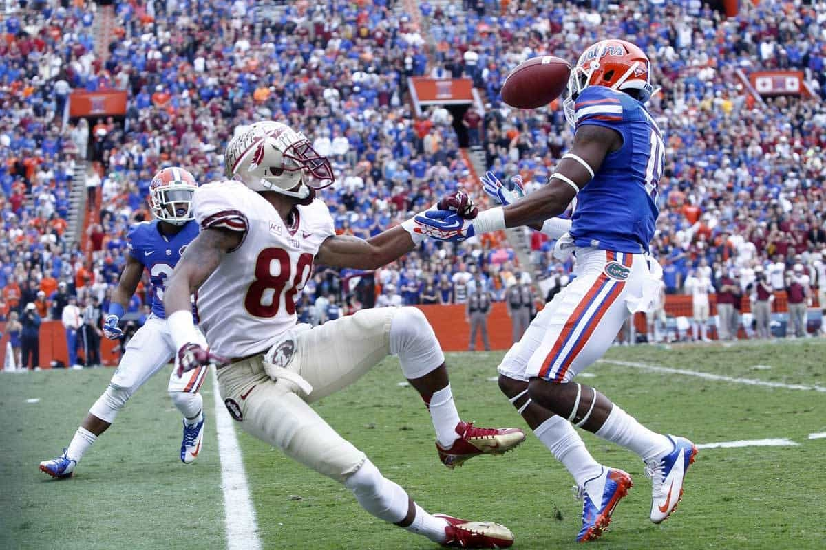 Nov 30, 2013; Gainesville, FL, USA; Florida Gators defensive back Loucheiz Purifoy (15) intercepts the ball from Florida State Seminoles wide receiver Rashad Greene (80) during the first quarter at Ben Hill Griffin Stadium. Photo: Kim Klement-USA TODAY Sports