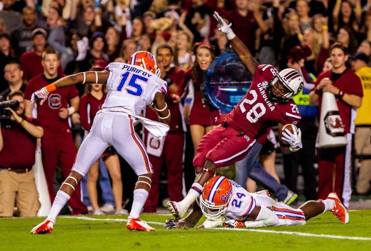 Nov 16, 2013; Columbia, SC, USA; South Carolina Gamecocks running back Mike Davis (28) is brought down by Florida Gators defensive back Brian Poole (24) as Florida Gators defensive back Loucheiz Purifoy (15) closes in in the first quarter at Williams-Brice Stadium. Photo: Jeff Blake-USA TODAY Sports