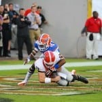 Loucheiz Purifoy sacks Georgia quarterback Aaron Murray for a safety / Gator Country Photo by David Bowie