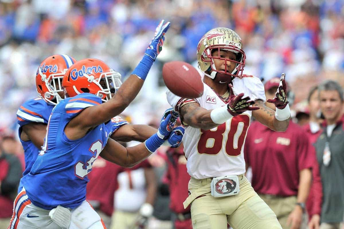 Nov 30, 2013; Gainesville, FL, USA; Florida State Seminoles wide receiver Rashad Greene (80) is unable to make a catch as Florida Gators defensive back Cody Riggs (31) defends the play during the second quarter at Ben Hill Griffin Stadium. Photo: Steve Mitchell-USA TODAY Sports