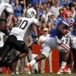 Nov 9, 2013; Gainesville, FL, USA; Florida Gators running back Kelvin Taylor (21) runs with the ball against the Vanderbilt Commodores during the second quarter at Ben Hill Griffin Stadium. Photo: Kim Klement-USA TODAY Sports