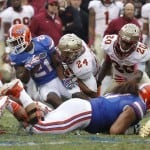 Nov 30, 2013; Gainesville, FL, USA; Florida Gators running back Kelvin Taylor (21) gets a first down as Florida State Seminoles linebacker Terrance Smith (24) defends during the second quarter at Ben Hill Griffin Stadium. Photo: Kim Klement-USA TODAY Sports