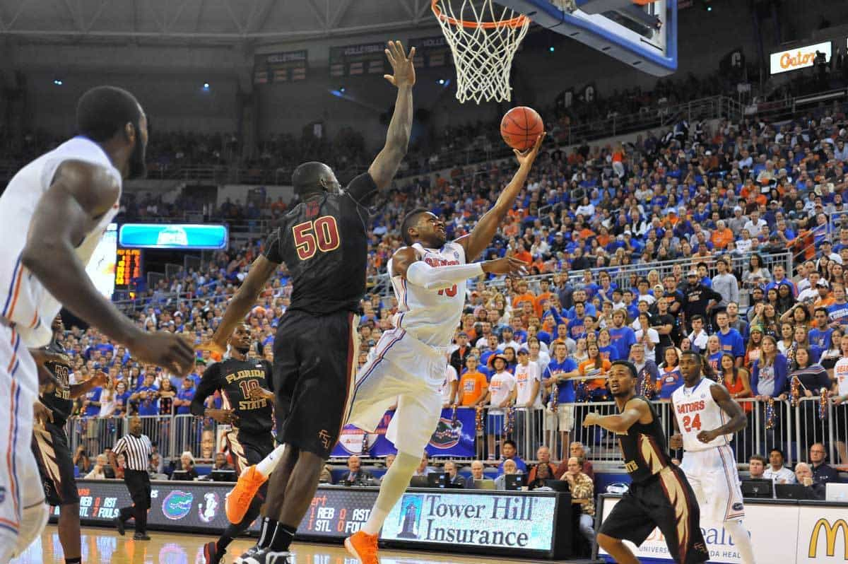 Will Yeguete drives to the hoop for a layup in Florida's 67-66 win over Florida State / Gator Country Photo by David Bowie