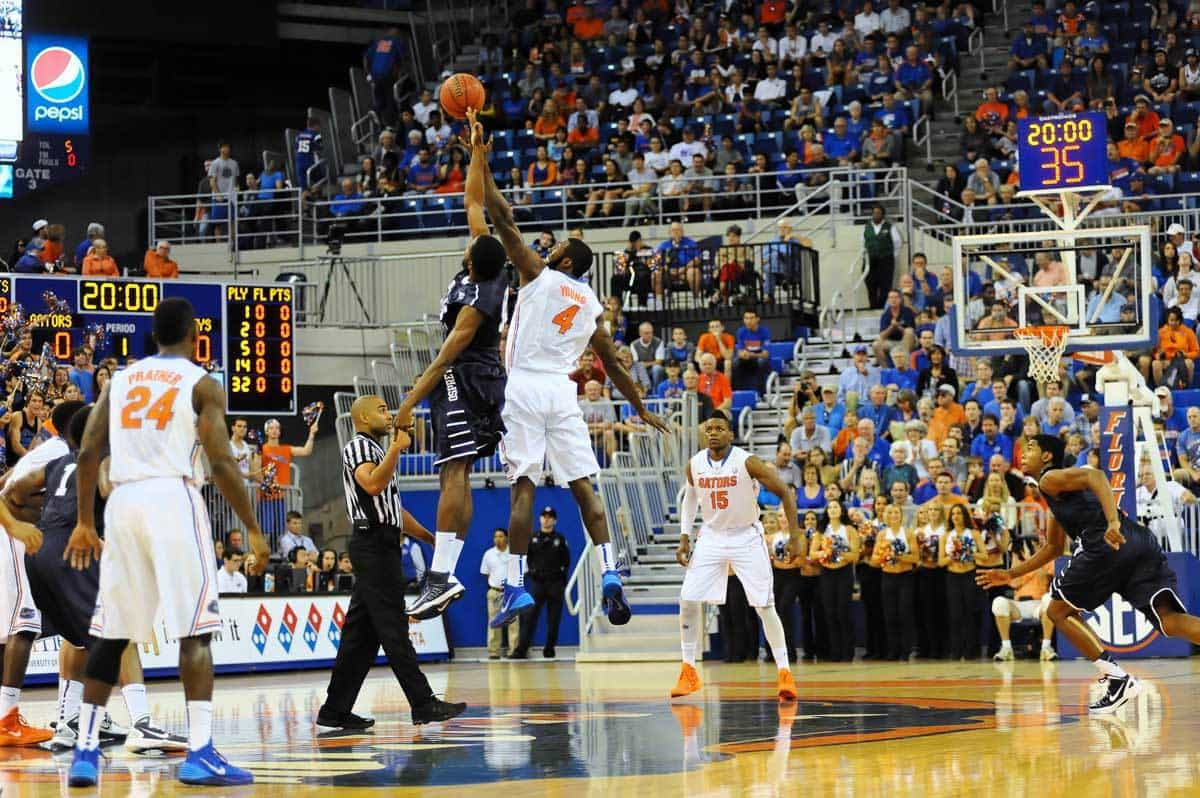 Patrick Young swats at the opening tipoff for the game against the North Florida Ospreys. Florida Gators vs North Florida Ospreys. Stephen C. O'Connell Center, Gainesville, FL. November 8, 2013. Photo: David Bowie.