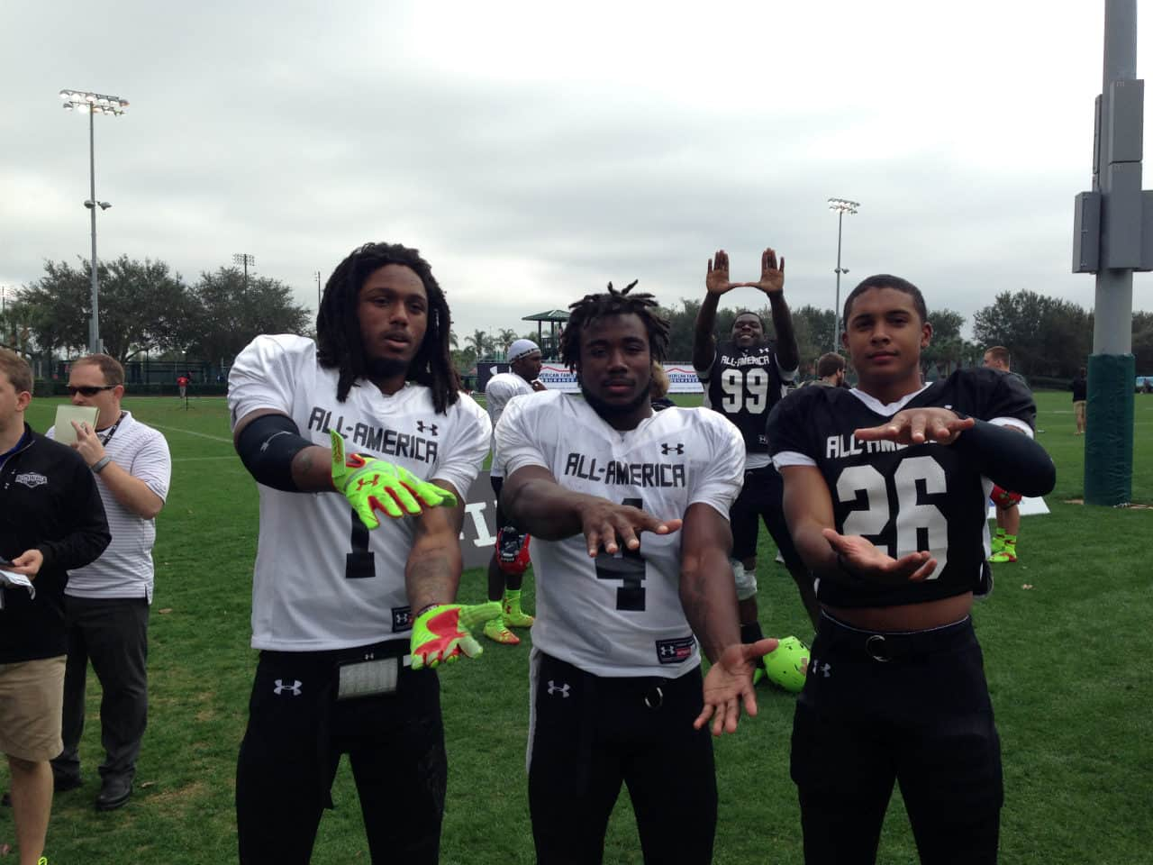 Ermon Lane (left), Dalvin Cook (center) and Quincy Wilson (right) Gator chomp after the second practice at the Under Armour All-American game.