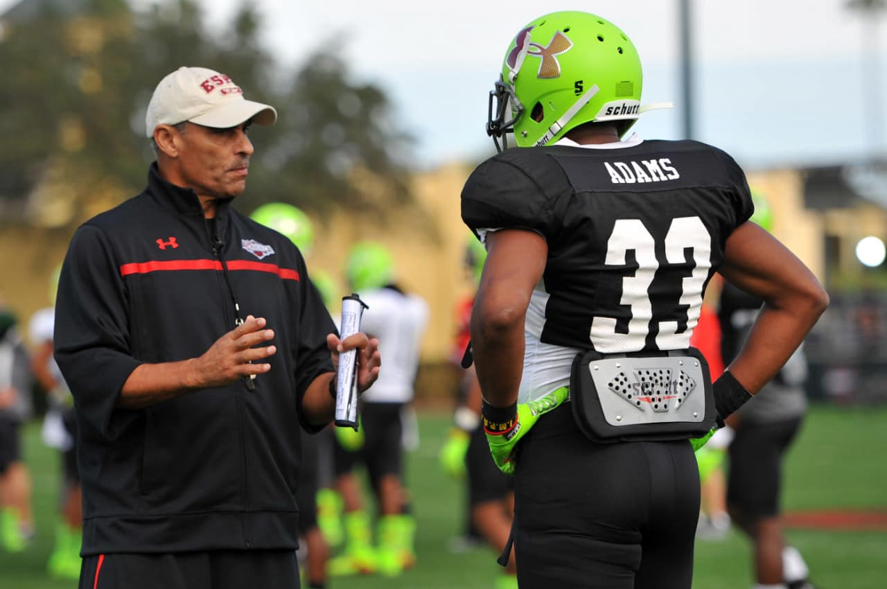 Herm Edwards coaches up Jamal Adams at the Under Armour All-American game.