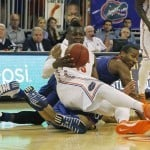 Dec 10, 2013; Gainesville, FL, USA; Florida Gators forward Will Yeguete (15) falls to the ground with Kansas Jayhawks forward Perry Ellis (34) as he is fouled during the first half at Stephen C. O'Connell Center. Photo: Kim Klement-USA TODAY Sports