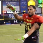 Gerald Willis chomps after the Under Armour All-American.