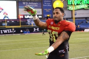 Gerald Willis chomps after the Under Armour All-American Game in January 2014