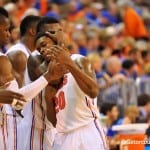 Michael Frazier gets plenty of encouragement and support from his senior teammates / Gator Country Photo by David Bowie
