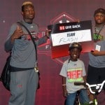 Lorenzo Carter and Damian Prince participate in the Under Armour build-a-bike charity event.