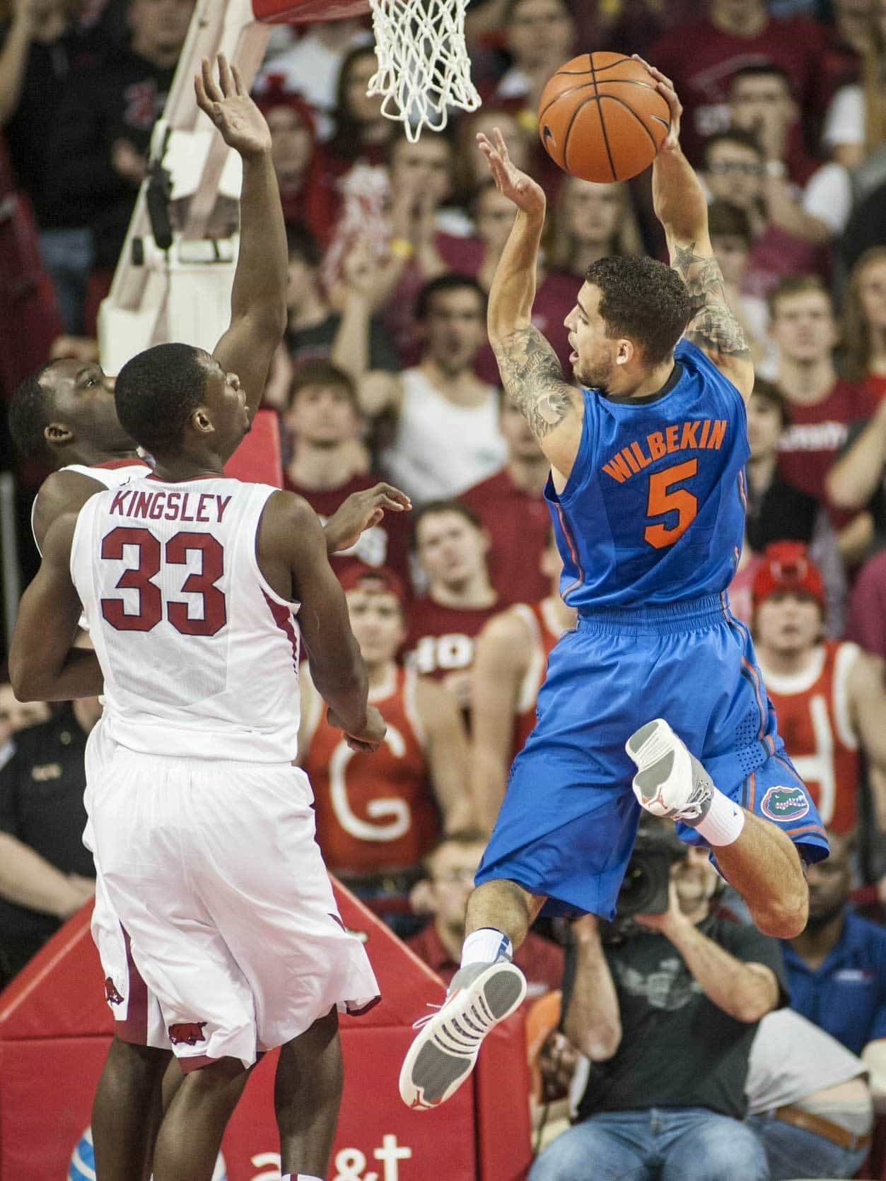 Jan 11, 2014; Fayetteville, AR, USA; Florida Gators guard Scottie Wilbekin (5) looks back to pass as Arkansas Razorbacks center Moses Kingsley (33) looks on during the first half of a game at Bud Walton Arena. Photo: Beth Hall-USA TODAY Sports
