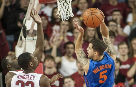 Wounded Gators rally past Hogs in overtime