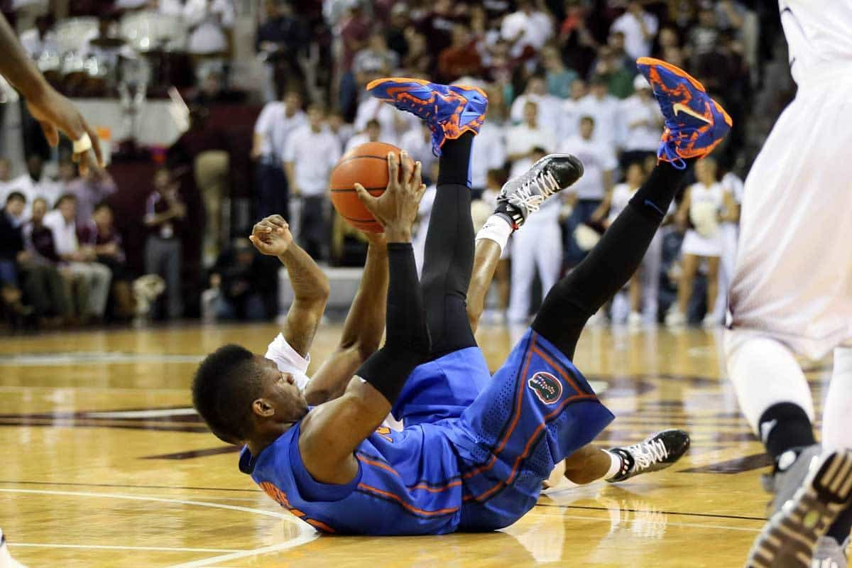 Jan 30, 2014; Starkville, MS, USA; Florida Gators forward Will Yeguete (15) grabs the loose ball and falls onto his back during the game against the Mississippi State Bulldogs at Humphrey Coliseum. Photo: Spruce Derden-USA TODAY Sports