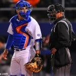 Taylor Gushue looks to Kevin O'Sullivan for the pitch call.