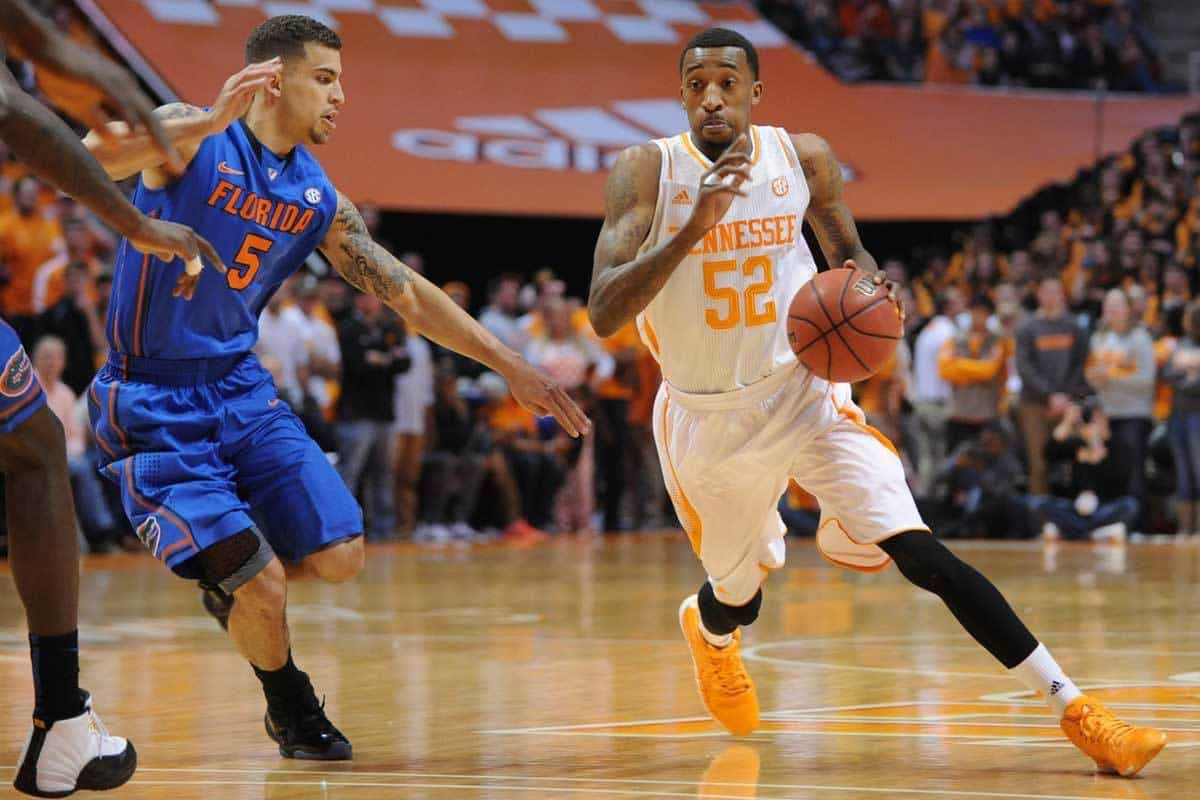 Feb 11, 2014; Knoxville, TN, USA; Tennessee Volunteers guard Jordan McRae (52) dribbles the ball around Florida Gators guard Scottie Wilbekin (5) during the first half at Thompson-Boling Arena. Photo: Randy Sartin-USA TODAY Sports