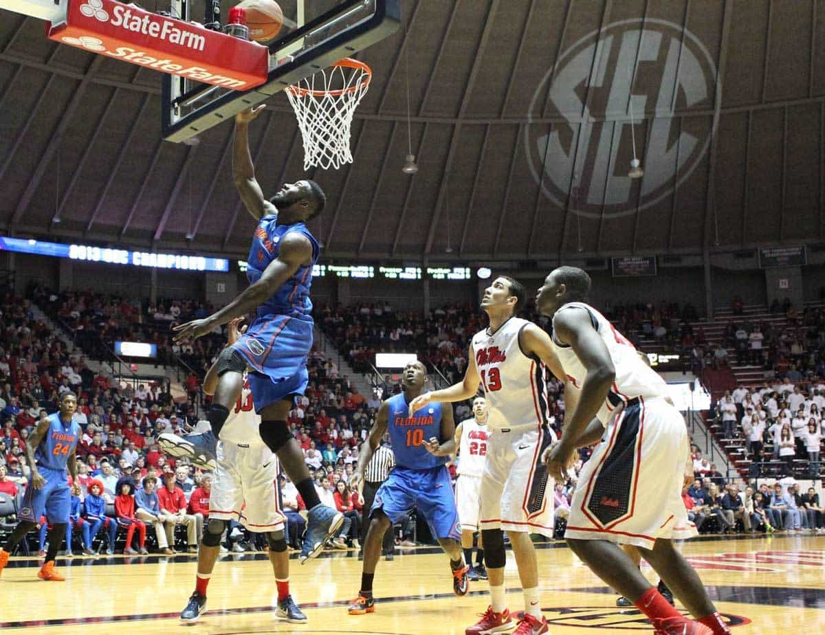 Feb 22, 2014; Oxford, MS, USA; Florida Gators center Patrick Young (4) drives to the basket in the first half against the Mississippi Rebels at Tad Smith Coliseum. Photo: Nelson Chenault-USA TODAY Sports