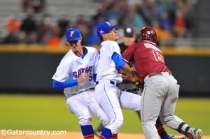D.J. Stewart collides with LHP Danny Young.
