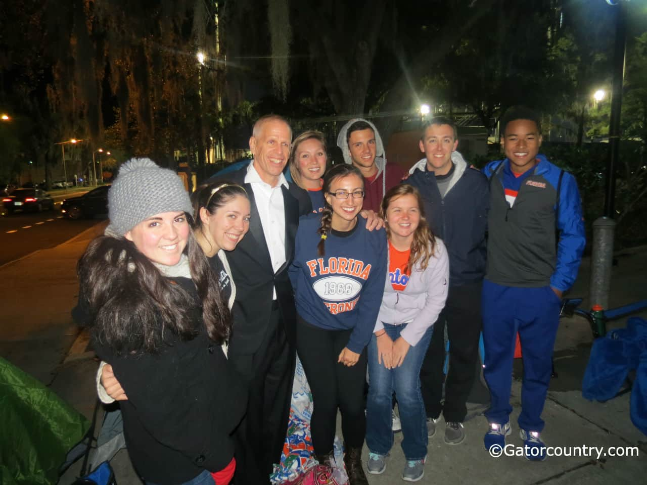 Florida athletic director Jeremy Foley poses for a picture with students camping out prior to the Florida-Kentucky basketball game.