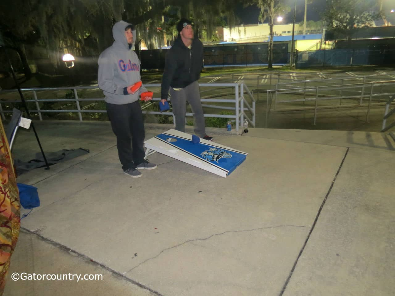 Students play the traditional tailgate game cornhole to pass the time.