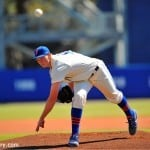 AJ Puk delivers a pitch in the first inning against Illinois.