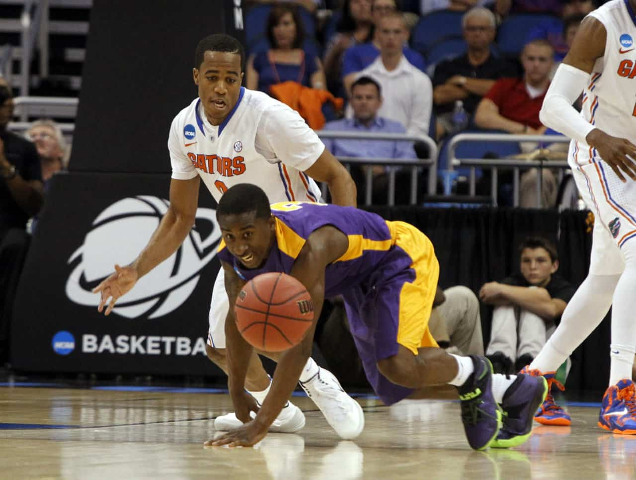 Mar 20, 2014; Orlando, FL, USA; Albany Great Danes guard DJ Evans (3) and Florida Gators guard Kasey Hill (0) go after a loose ball during the second half of a men's college basketball game during the second round of the 2014 NCAA Tournament at Amway Center. Photo: Kim Klement-USA TODAY Sports