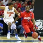 Mar 29, 2014; Memphis, TN, USA; Dayton Flyers guard Khari Price (0) drives against Florida Gators guard Kasey Hill (0) during the second half in the finals of the south regional of the 2014 NCAA Mens Basketball Championship tournament at FedEx Forum. Photo by: Spruce Derden-USA TODAY Sports