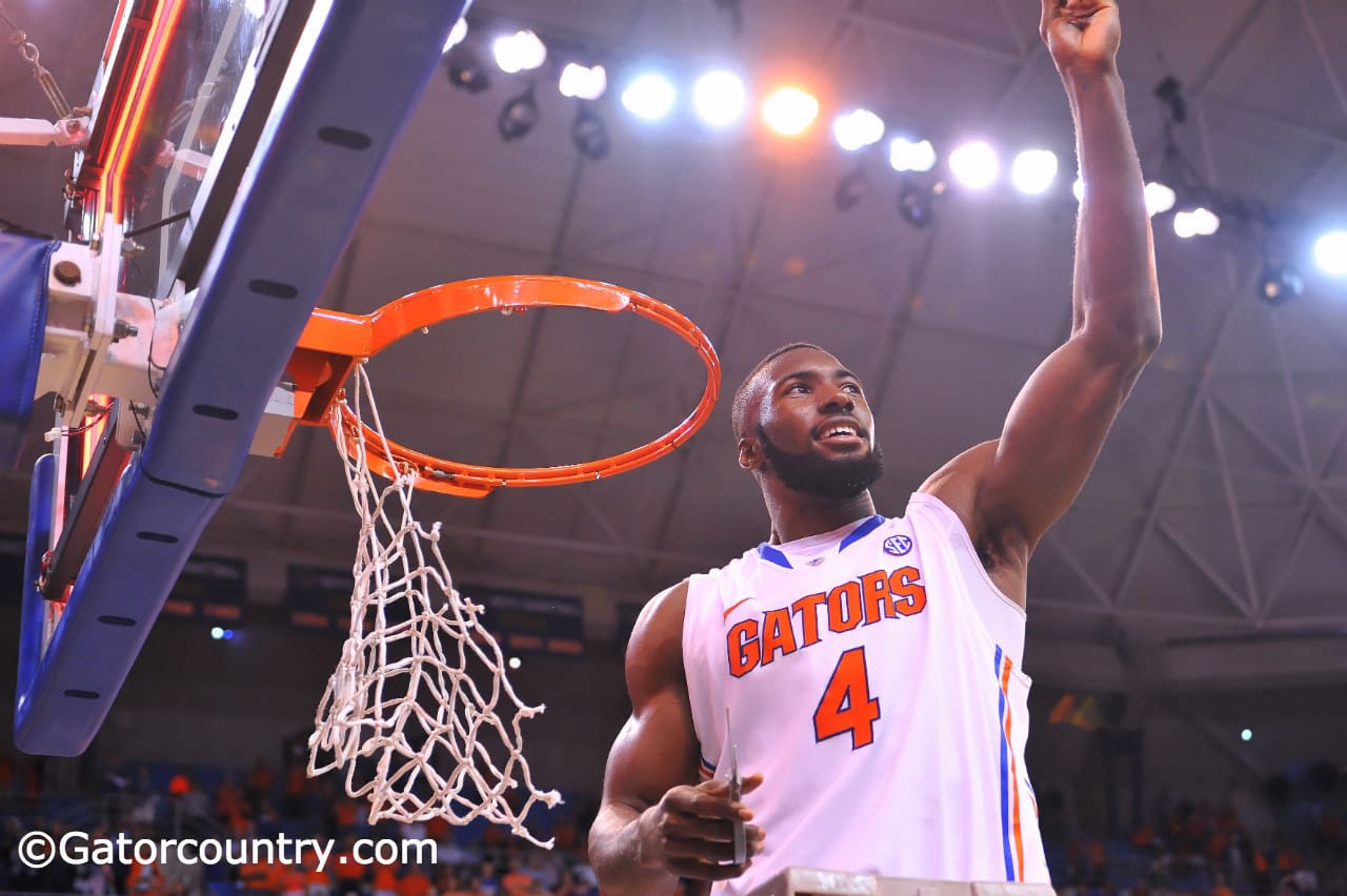 Patric Young cuts down the nets after the Gators finished the regular season with a win over Kentucky / Gator Country Photo by David Bowie