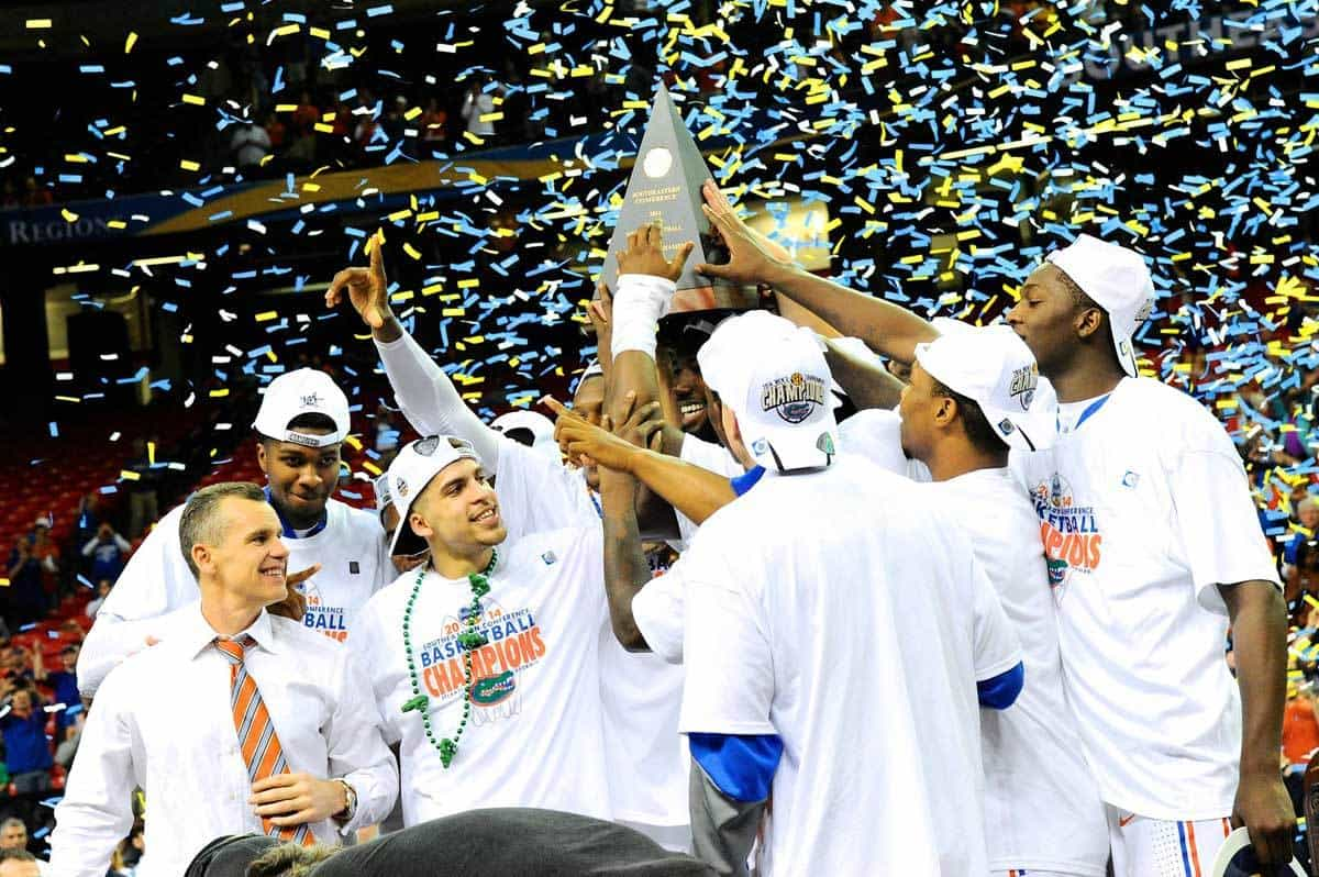 Mar 16, 2014; Atlanta, GA, USA; Florida Gators players and head coach Billy Donovan celebrate after defeating the Kentucky Wildcats in the championship game for the SEC college basketball tournament at Georgia Dome. Florida defeated Kentucky 61-60. Photo: Dale Zanine-USA TODAY Sports