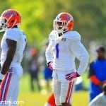 Vernon Hargreaves and Duke Dawson work with Travaris Robinson during spring practice.
