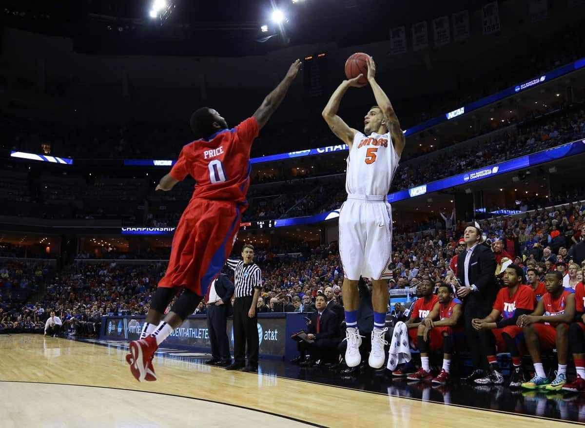 Mar 29, 2014; Memphis, TN, USA; Florida Gators guard Scottie Wilbekin (5) shoots against Dayton Flyers guard Khari Price (0) during the first half in the finals of the south regional of the 2014 NCAA Mens Basketball Championship tournament at FedEx Forum. Photo: Spruce Derden-USA TODAY Sports