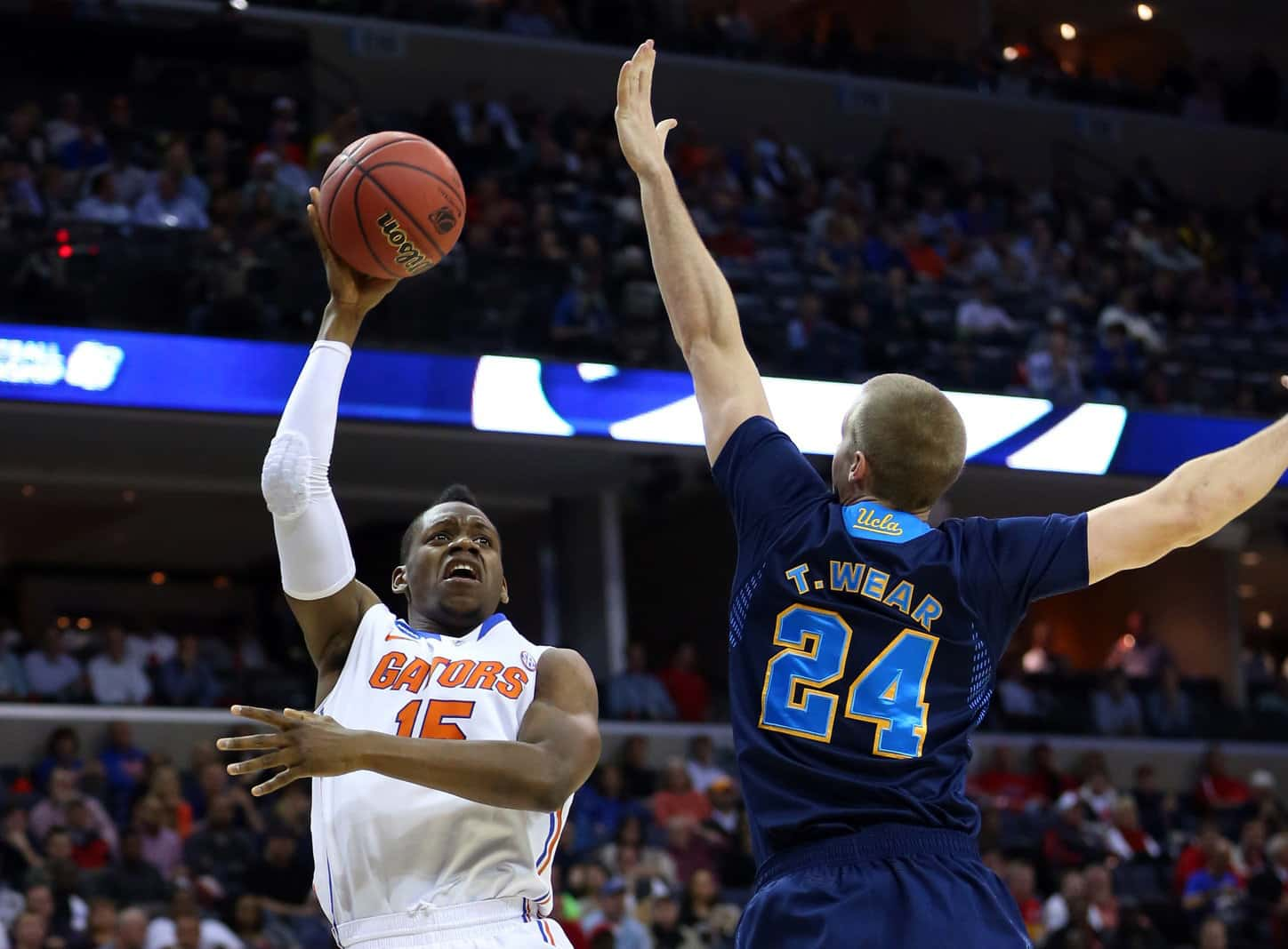 Mar 27, 2014; Memphis, TN, USA; Florida Gators forward Will Yeguete (15) shoots against UCLA Bruins forward Travis Wear (24) during the first half in the semifinals of the south regional of the 2014 NCAA Mens Basketball Championship tournament at FedExForum. Photo By: Spruce Derden-USA TODAY Sports