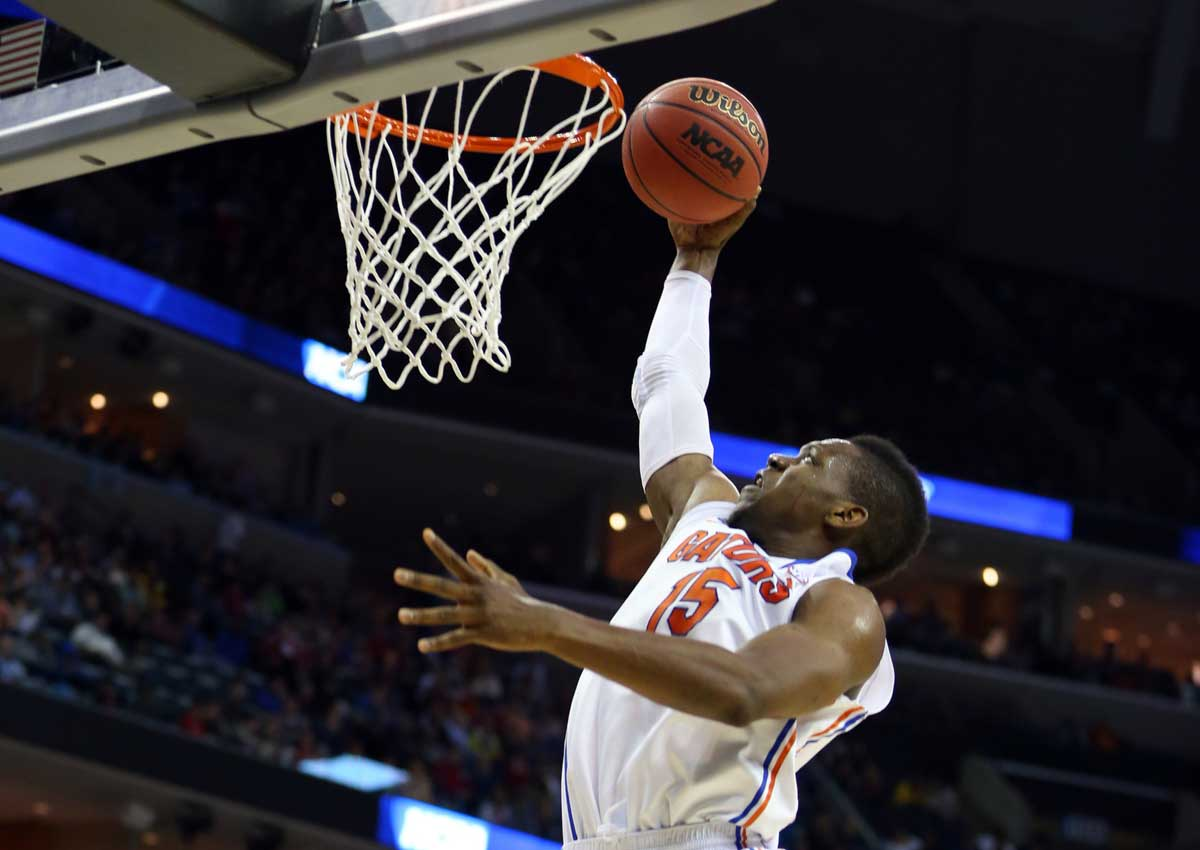 Mar 27, 2014; Memphis, TN, USA; Florida Gators forward Will Yeguete (15) drives to the basket against the UCLA Bruins during the first half in the semifinals of the south regional of the 2014 NCAA Mens Basketball Championship tournament at FedExForum. Photo: Spruce Derden-USA TODAY Sports