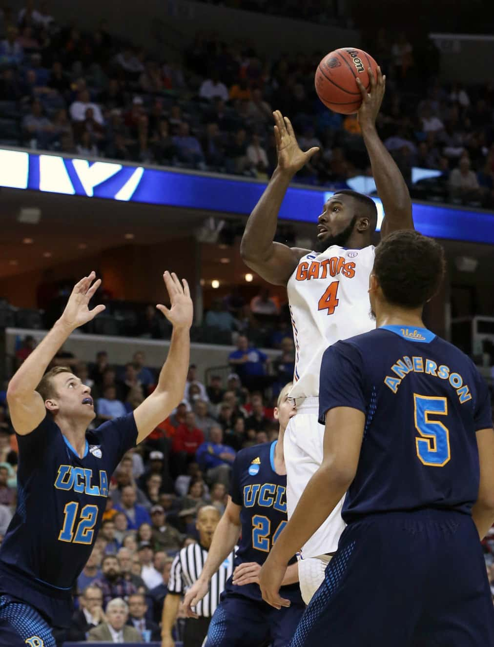 Mar 27, 2014; Memphis, TN, USA; Florida Gators center Patric Young (4) shoots over UCLA Bruins forward David Wear (12) during the second half in the semifinals of the south regional of the 2014 NCAA Mens Basketball Championship tournament at FedExForum. Photo by: Nelson Chenault-USA TODAY Sports
