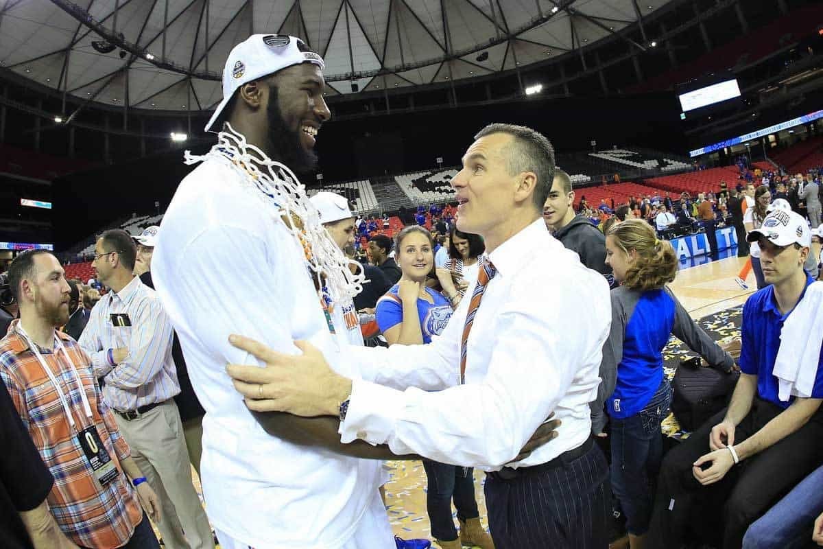 Mar 16, 2014; Atlanta, GA, USA; Florida Gators center Patric Young (4) and head coach Billy Donovan celebrate defeating the Kentucky Wildcats in the championship game for the SEC college basketball tournament at Georgia Dome. Florida won 61-60. Photo: Paul Abell-USA TODAY Sports