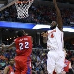 Mar 29, 2014; Memphis, TN, USA; Florida Gators center Patric Young (4) shoots over Dayton Flyers forward Kendall Pollard (22) during the second half of the final in the south regional of the 2014 NCAA Mens Basketball Championship tournament at FedExForum. Photo: Nelson Chenault-USA TODAY Sports