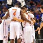 The starting five huddle together at mid court before the tip off.  Florida Gators vs Pitt Panthers.  March 22nd, 2014.  Gator Country photo by David Bowie.