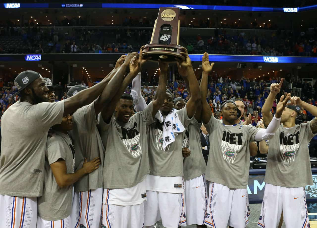 Mar 29, 2014; Memphis, TN, USA; Florida Gators celebrate defeating the Dayton Flyers 62-52 in the final in the south regional of the 2014 NCAA Mens Basketball Championship tournament at FedExForum. Photo by: Nelson Chenault-USA TODAY Sports