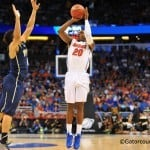 Florida guard Michael Frazier puts up the 3-pointer over Pitt guard James Robinson.  Florida Gators vs Pitt Panthers.  March 22nd, 2014.  Gator Country photo by David Bowie.