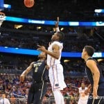 Florida forward Will Yeguete turns and releases a floating shot in the second half.  Florida Gators vs Pitt Panthers.  March 22nd, 2014.  Gator Country photo by David Bowie.