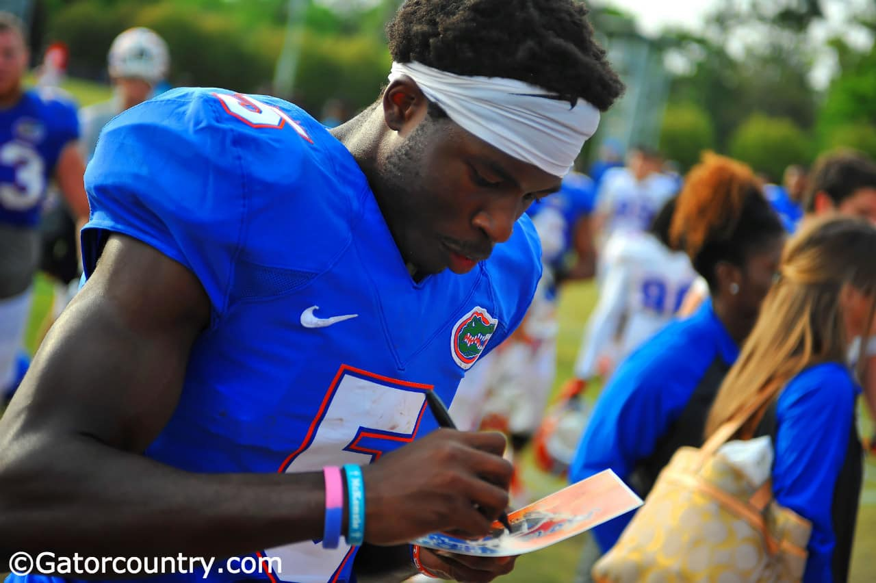 Ahmad Fulwood signs autographs for fans after spring practice.
