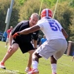 D.J. Durkin works with Mike Taylor during spring practice. / Photo by David Bowie