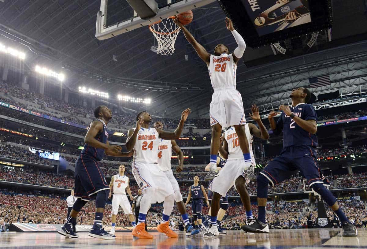 Apr 5, 2014; Arlington, TX, USA; Florida Gators guard Michael Frazier II (20) reaches for the rebound against Connecticut Huskies forward DeAndre Daniels (2) during the semifinals of the Final Four in the 2014 NCAA Mens Division I Championship tournament at AT&T Stadium. Photo: Robert Deutsch-USA TODAY Sports