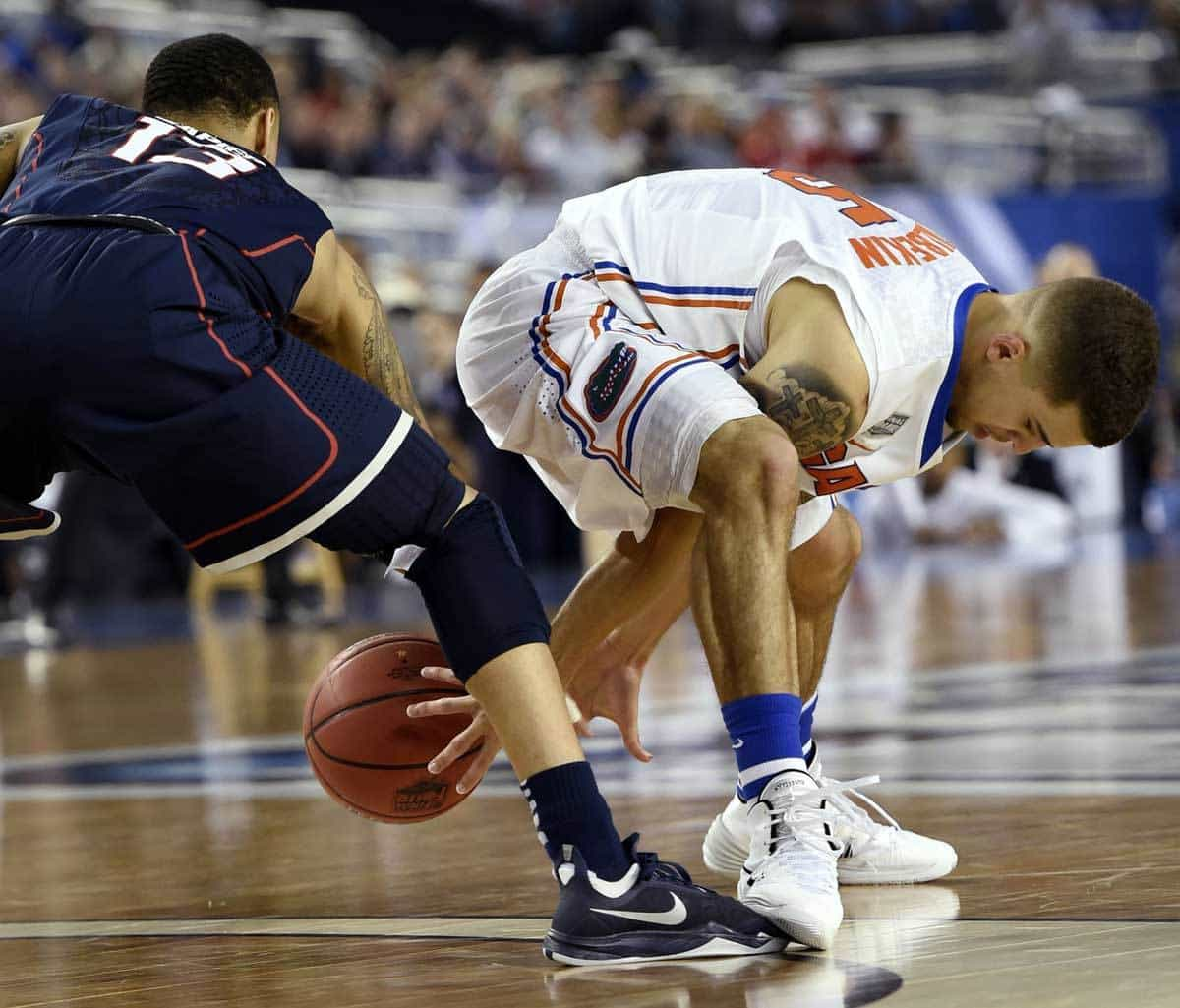 Apr 5, 2014; Arlington, TX, USA; Florida Gators guard Scottie Wilbekin (5) reaches for the ball between his legs against Connecticut Huskies guard Shabazz Napier (13) in the second half during the semifinals of the Final Four in the 2014 NCAA Mens Division I Championship tournament at AT&T Stadium. Photo: Robert Deutsch-USA TODAY Sports