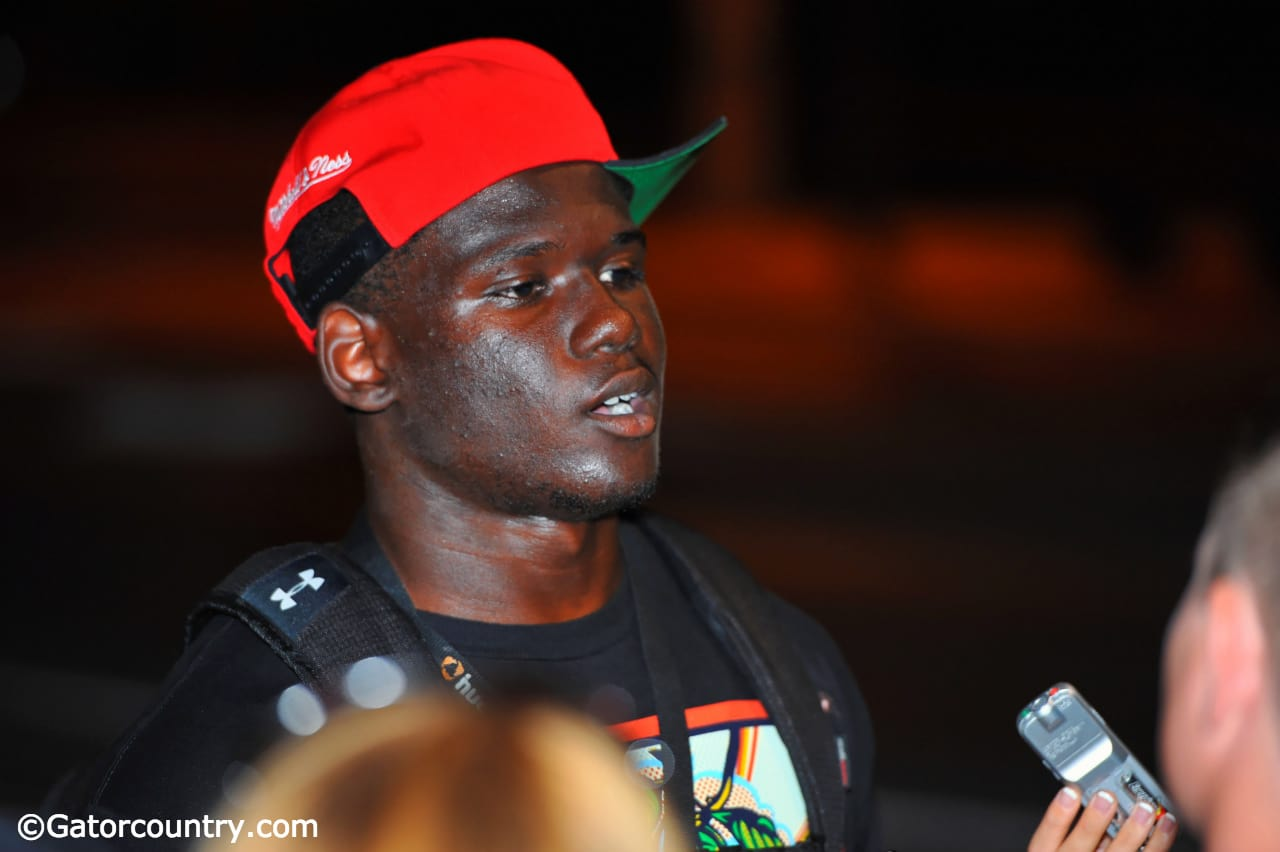 Tim Irvin talks with reporters in Gainesville after Friday Night Lights