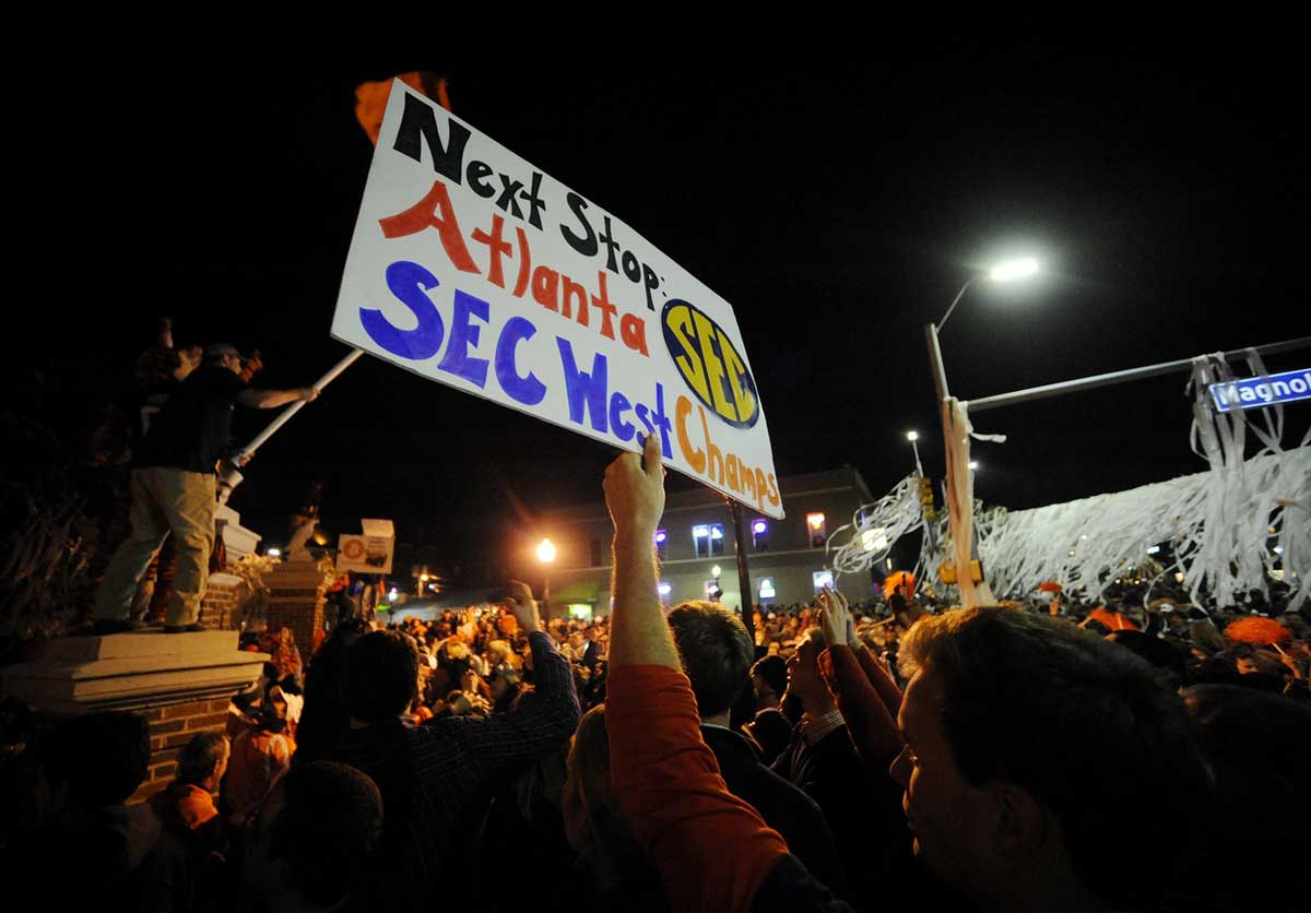Nov 30, 2013; Auburn, AL, USA; A fan holds up a sign at Toomer's Corner after the game between the Alabama Crimson Tide and the Auburn Tigers at Jordan Hare Stadium. The Tigers defeated the Crimson Tide 34-28. Photo: Shanna Lockwood-USA TODAY Sports