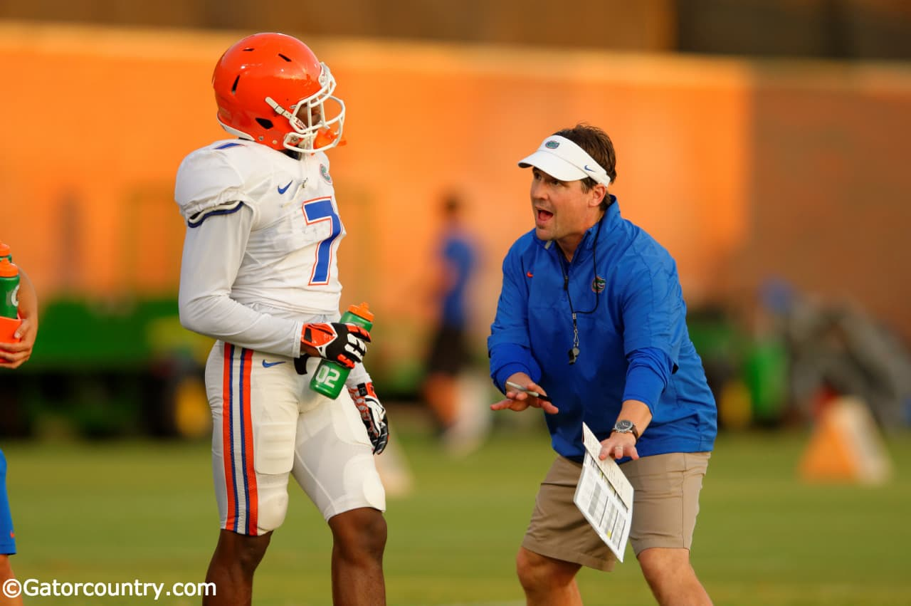 Will Muschamp instructs freshman cornerback Duke Dawson during practice. / Photo by Davd Bowie