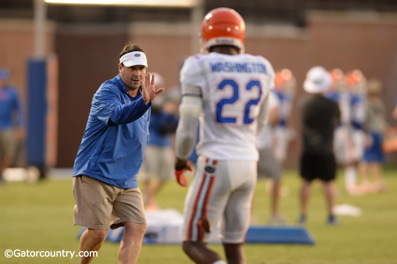 Will Muschamp coaches up Nick Washington during fall camp. / Photo by David Bowie