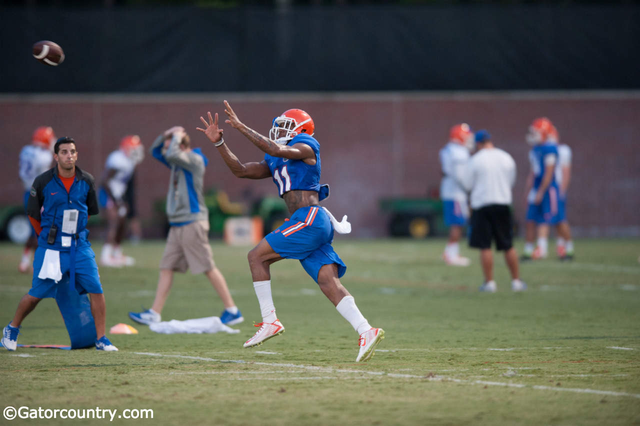 Demarcus Robinson goes through drills during fall camp. / Photo by David Bowie