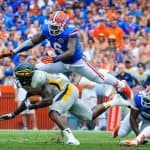 Florida Gators Football: Dominique Easley tackles opposing player on Florida Field, Gainesville, Fl